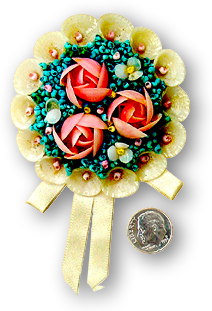 A floral brooch made from seashells